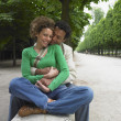 African couple hugging in park — Stock Photo