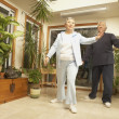 senior asian couple doing tai chi indoors — Stock Photo #13223425