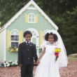 Boy and girl at pretend wedding — Stock Photo #13223435