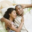 African American couple sleeping in hammock — Stock Photo
