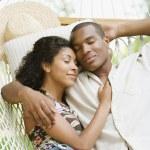 African American couple sleeping in hammock — Stock Photo