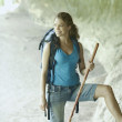 Stock Photo: Young womhiking in canyon