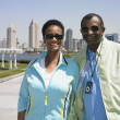 Senior African couple smiling with cityscape in background — Stok fotoğraf