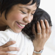 Stock Photo: Hispanic mother hugging baby