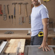 Portrait of man with table saw - Stok fotoğraf