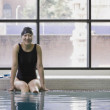 Female Asian swimmer with legs in pool - Stok fotoğraf