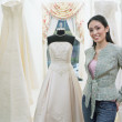 Young woman standing in a bridal boutique — Stock Photo