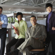 Group of businesspeople in office - Stock Photo