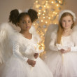 Portrait of two girls dressed as angels — Photo