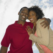 Stock Photo: Low angle view of Africcouple smiling