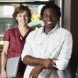 Coworkers smiling for the camera — Stock Photo