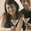 Portrait of couple drinking martinis — Stock Photo