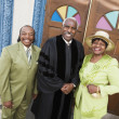Portrait of senior African American couple and Reverend - Stock Photo