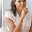 African American woman holding electronic organizer — Stock Photo