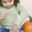 Little girl eating candy corn - Stock Photo