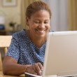 Woman using a laptop — Stock Photo