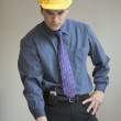 Stock Photo: Businessmwearing hard hat