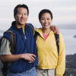 Portrait of couple hiking with valley behind them — Stock Photo