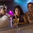 Couple being bothered by person at bar — Stock Photo #13223884