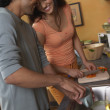 Couple cooking in kitchen — Stockfoto