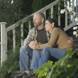 Couple hugging on porch steps — Stock Photo #13224039