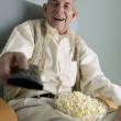 Elderly man watching television — Stock Photo