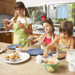 Hispanic sisters making cookies — Stock Photo