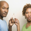 African couple holding wishbone — Stock Photo