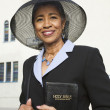 Senior African American woman in front of church - Stock Photo