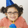 Stock Photo: Young girl with birthday cupcake