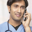 Royalty-Free Stock Photo: Male nurse talking on the phone