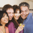 Multi-ethnic group of friends taking own photograph — Stock Photo