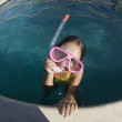 Girl in swimming pool wearing goggles — Stock Photo
