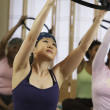 Stock Photo: Multi-ethnic women in exercise class