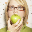 Stock Photo: Young woman eating apple