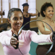 Multi-ethnic women in exercise class — 图库照片