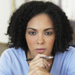 African businesswoman holding pen - Stock Photo
