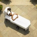 Young woman having a scalp massage — Stock Photo