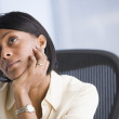 Stock Photo: African American businesswoman thinking