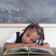 School girl laying on book - Stock Photo