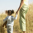 Stock Photo: Mother and daughter standing in field