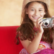 Portrait of girl taking picture - Stock Photo