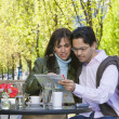Hispanic couple looking at street map — Stock Photo