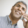 Middle aged man talking on his cell phone — Stock Photo