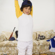 Boy in sports gear lifting weights - Stok fotoğraf