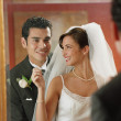 Newlywed couple looking at themselves in mirror — Stock Photo #13224546