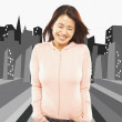Asian woman laughing with hands in pockets — Stock Photo