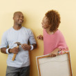 Couple with picture and hammer — Stock Photo
