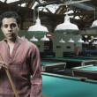 Portrait of man playing pool — Stok fotoğraf