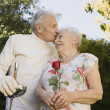 Royalty-Free Stock Photo: Senior man in fencing gear kissing wife